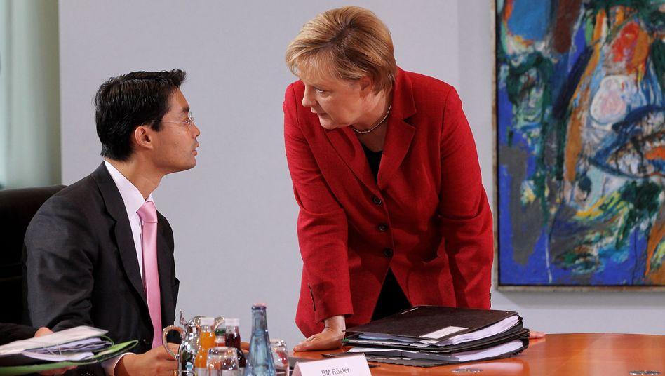 Kanzlerin Merkel, Vize Rösler: Täglich ein Kampf um den richtigen Kurs
