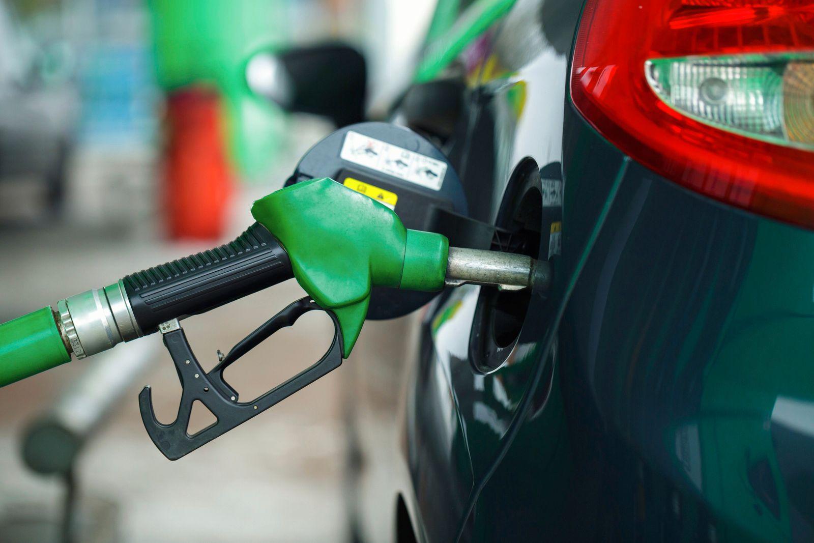Car refueling on a petrol station in winter closeup (vladstar)