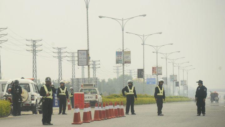 Unruhen in China: Wütende Bürger, bewaffnete Beamte