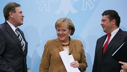 BERLIN - JULY 03: German Chancellor Angela Merkel and Economy Minister Michael Glos after an energy summit in July. Merkel is struggling to find a way to phase out nuclear power by 2020 -- without introducing something even more environmentally damaging.