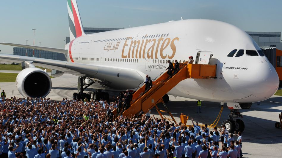 Workers at the Airbus plant in Hamburg's Finkenwerder district celebrate the 2008 delivery of the first A380 aircraft to Emirates airlines.