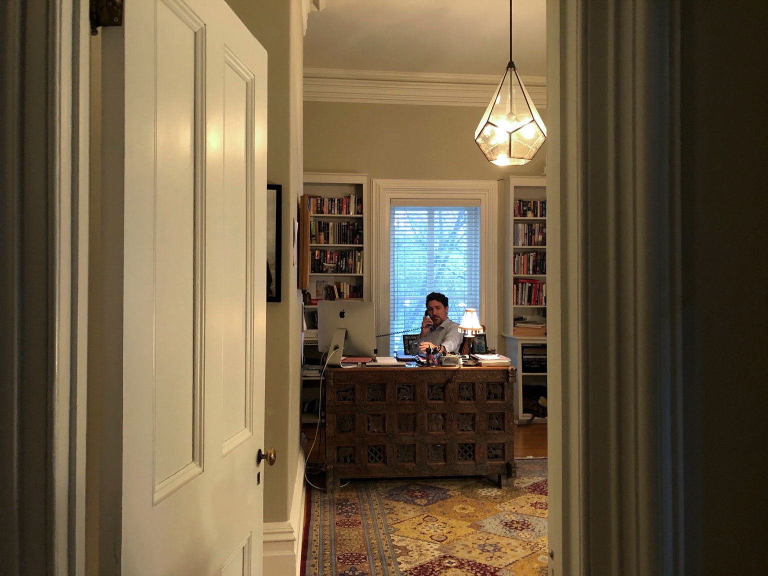 Canada?s Prime Minister Justin Trudeau works from his home office at Rideau Cottage, during his self-quarantine after his wife Sophie Gregoire tested positive for novel coronavirus, in Ottawa