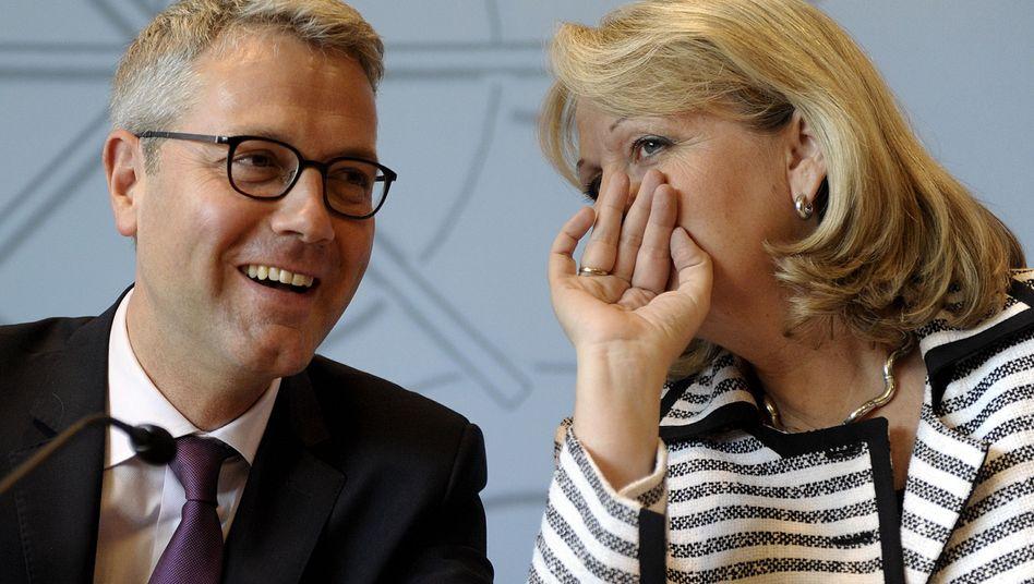 Gute Laune: CDU-Landeschef Röttgen und Ministerpräsidenten Kraft feiern den Kompromiss