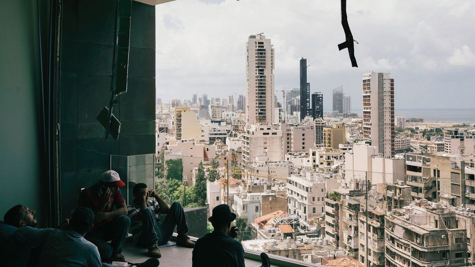 """View of Beirut from a destroyed apartment: """"This cursed state does nothing to help the people, nothing."""""""