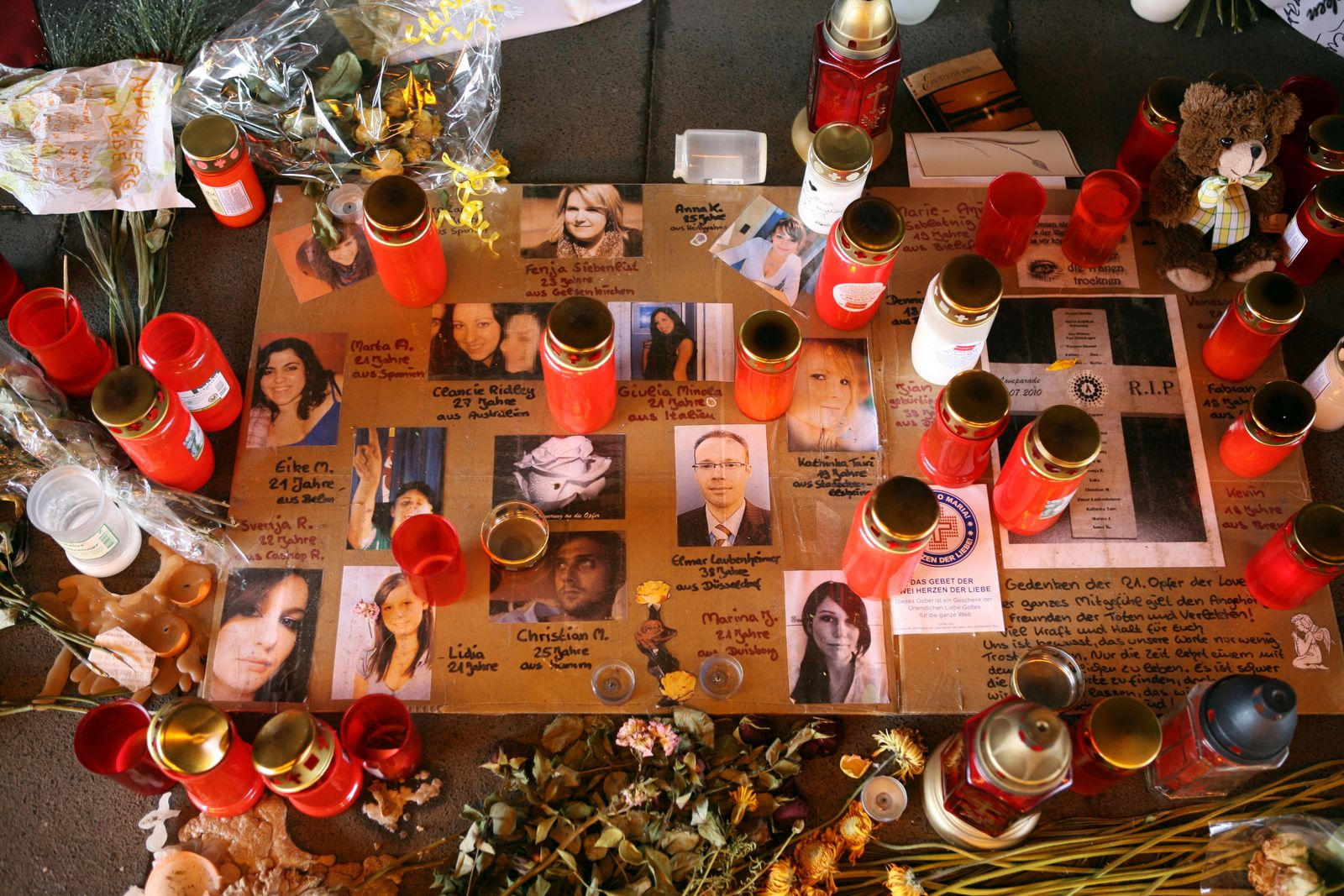 Candles and flowers are laid down with p