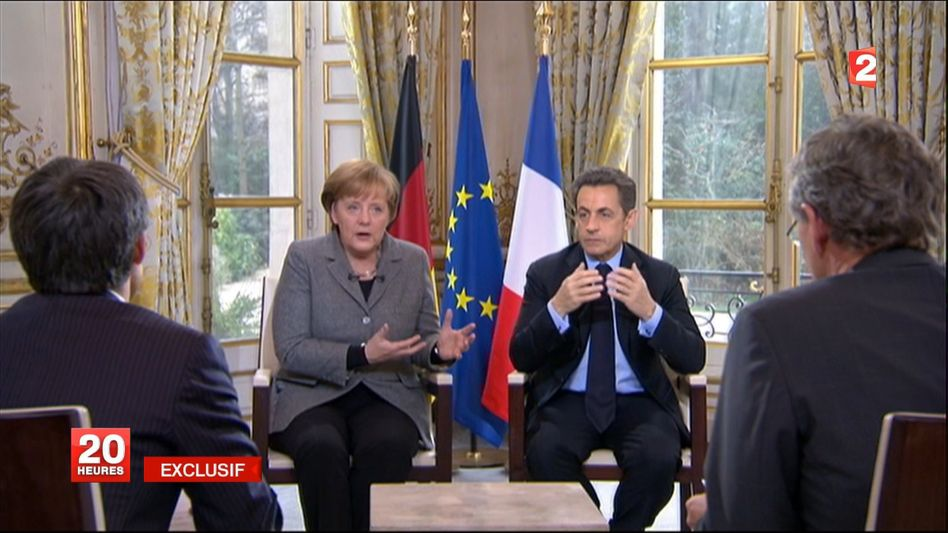 Germany Chancellor Angela Merkel and French President Nicolas Sarkozy appeared jointly for a Monday afternoon television interview in Paris.
