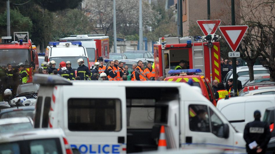 French police and firefighters around the Toulouse apartment building where Mohammed Mareh was holed up on Wednesday