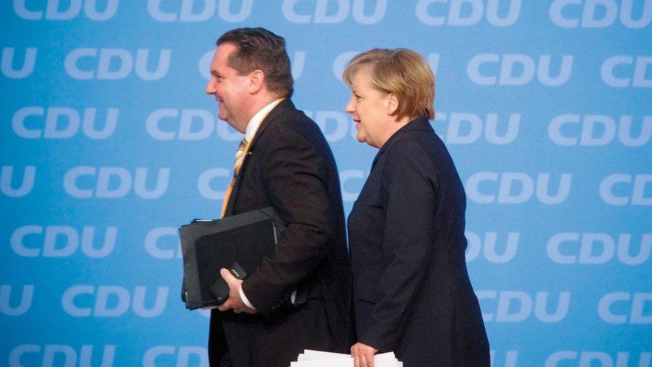 Parteifreunde Mappus, Merkel: Ihre Geschichte offenbart den Opportunismus der CDU