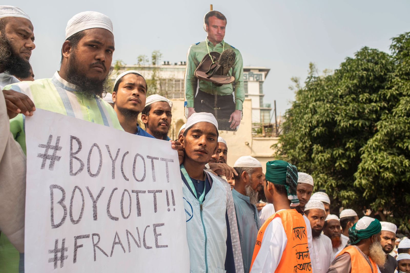 October 27, 2020, Dhaka, Bangladesh: A Muslim protester displays a placard reading Boycott Boycott!! France during the