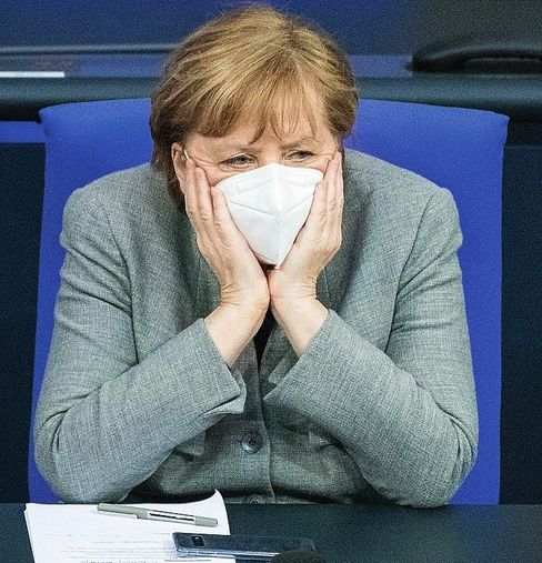 "Chancellor Merkel wearing an FFP2 mask: ""Germany is facing eight to 10 difficult weeks."""