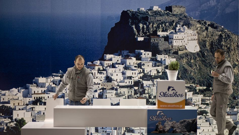 Workers at the ITB Travel Trade Show in Berlin set up the Greece display.