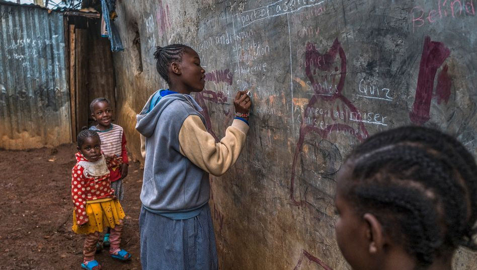 Children in a Kenyan slum: Around the world, school closures are dimming the future prospects of today's students.