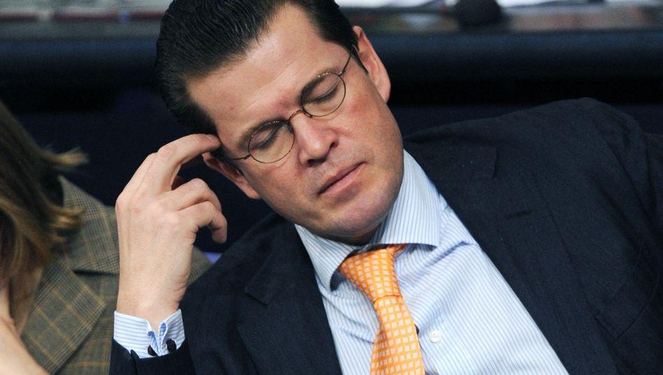 German Defense Minister Karl-Theodor zu Guttenberg has had a long week.