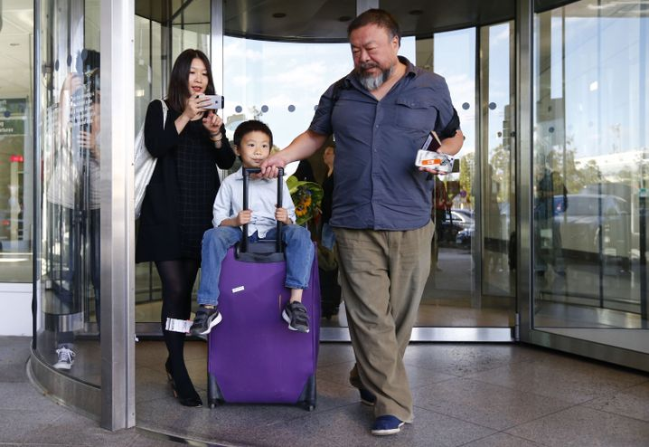 Ai Weiwei, his partner Wang Fen and their son Ai Lao arriving in Munich on July 30.