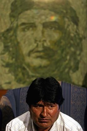 Bolivian President Evo Morales sits in front of a picture made out of coca leaves depicting leftist revolutionary Ernesto Che Guevara.