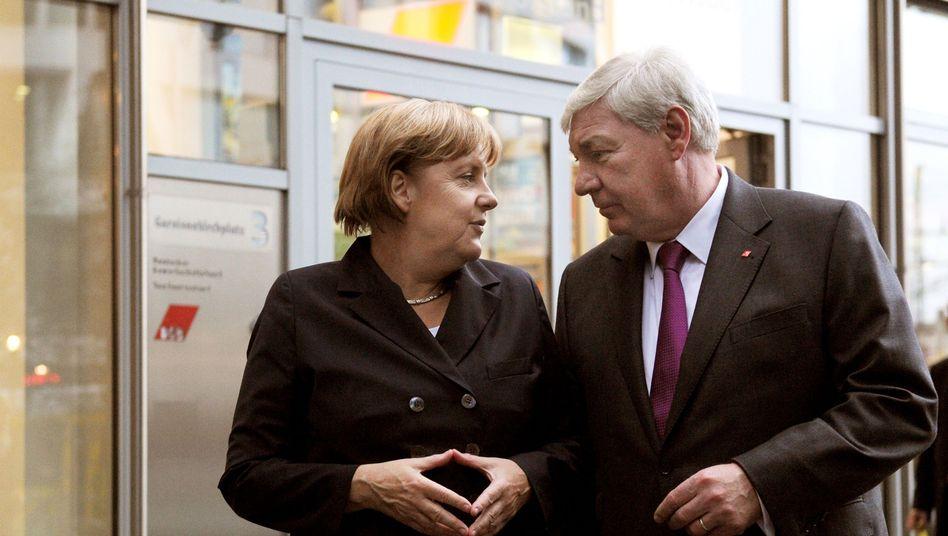 Kanzlerin Merkel, DGB-Chef Sommer: Flirt mit der Lohnuntergrenze
