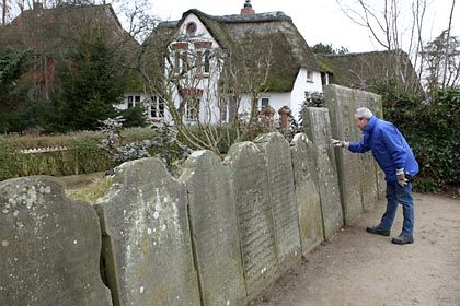 """A man inspects the """"speaking stones"""" of Amrum."""