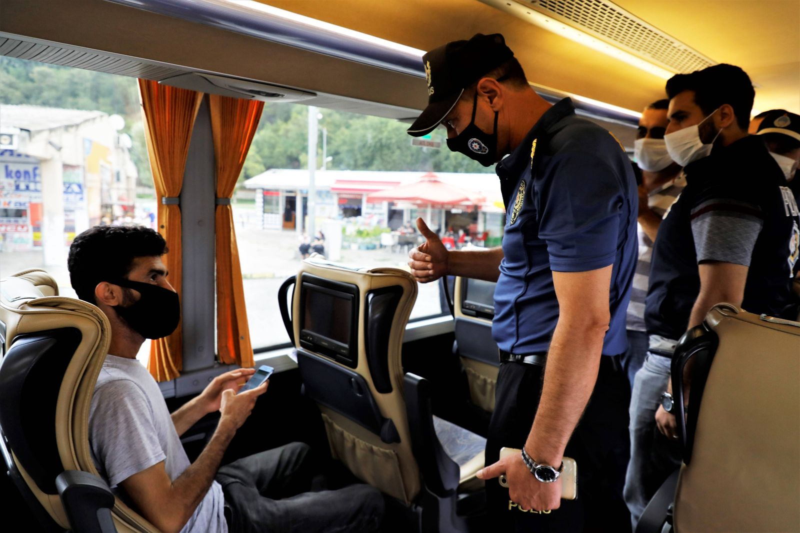 (200904) -- ISTANBUL, Sept. 4, 2020 -- A police officer inspects a passenger on a bus in Istanbul, Turkey, on Sept. 4, 2