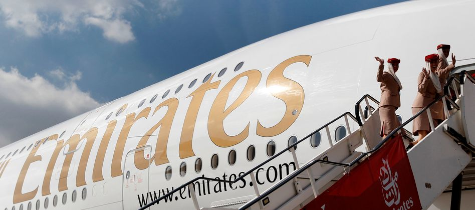 Emirates cabin crew board an Emirates Airbus A380-800 at Manchester Airport in England