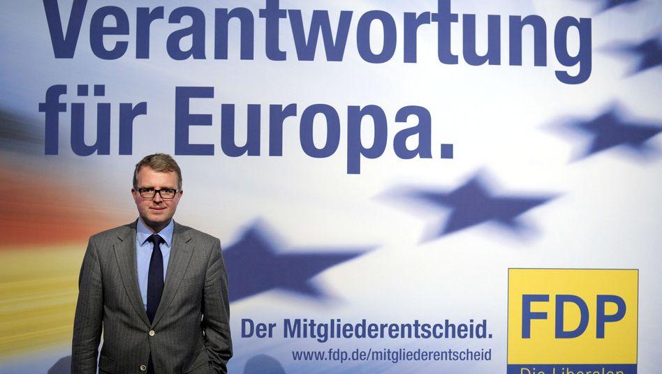 Euro-Rebell Schäffler vor FDP-Plakat zum Mitgliederentscheid: Wohin steuert die Partei?