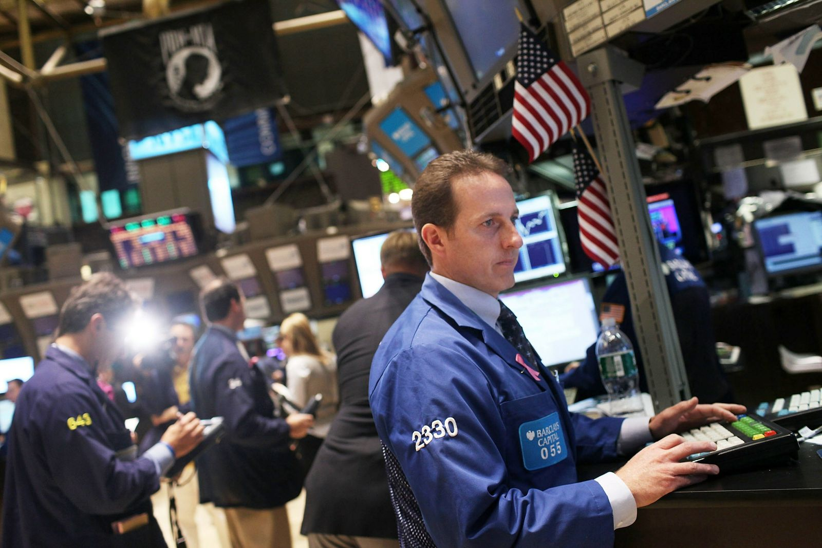 Dow Passes Inches Pass 11,000 Mark