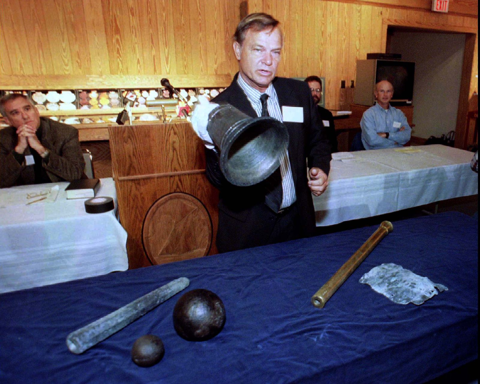 MARITIME REASEARCH REPRESENTATIVE DISPLAYS RECOVERED BELL