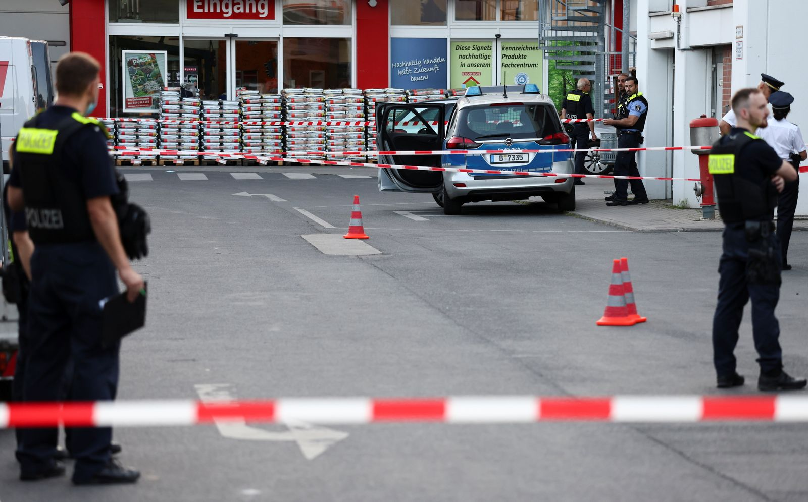 Police officers secure parking space after shots fired outside Berlin store