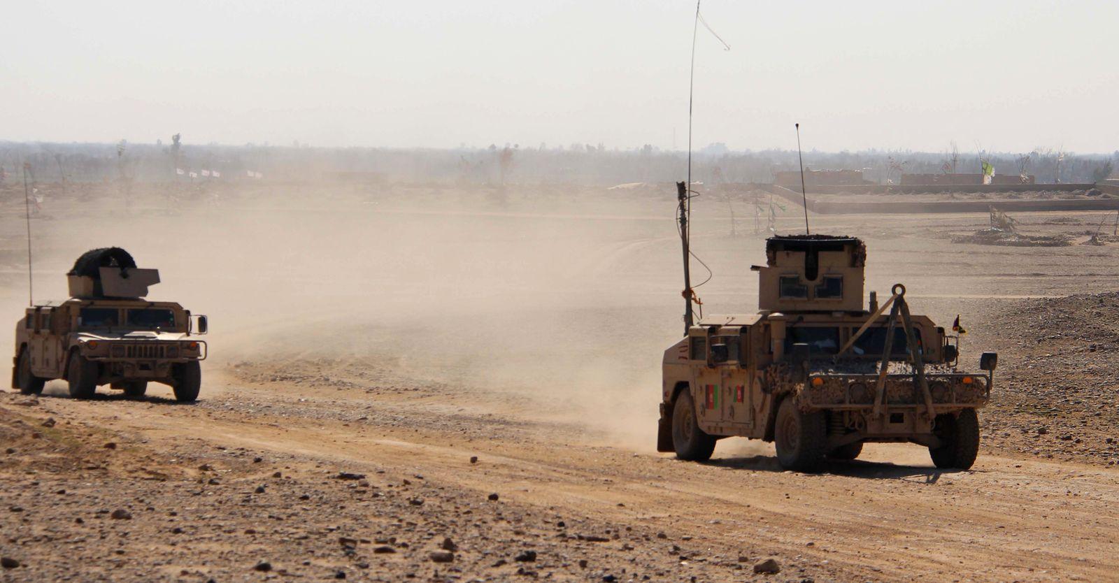 Afghan security officials patrol in Helmand, Afghanistan - 03 Mar 2020
