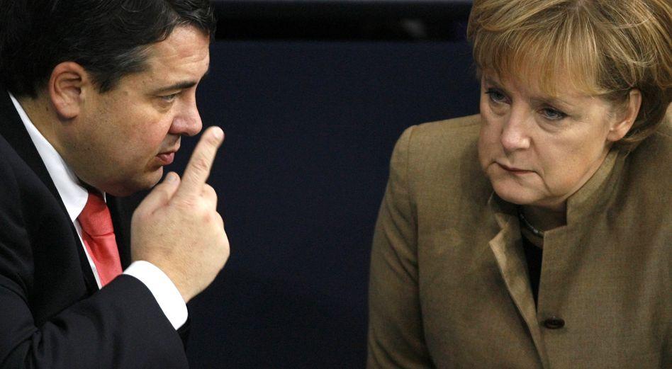 SPD-Chef Gabriel, Kanzlerin Merkel: Wo bitte geht's zur Integration?