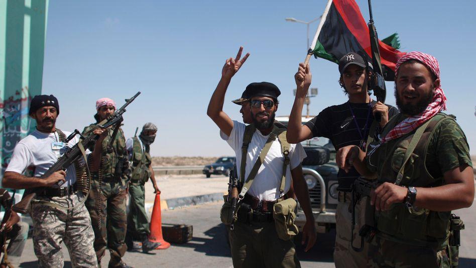 Libysche Rebellen an der Straße nach Brega: Hauptverkehrsadern unter Kontrolle