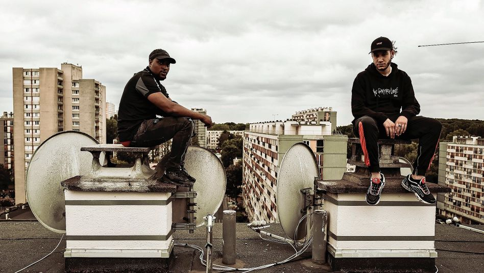 """Mahmoud Kebe and Doğukan Kur on the roof of a residential high-rise: """"I don't get funny looks here in Clichy like I do in Paris."""""""