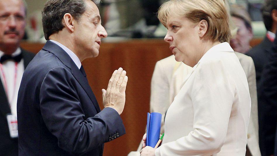 """EU-Gipfel-Teilnehmer Sarkozy, Merkel: """"Niemand will als derjenige ins Geschichtsbuch eingehen, der den Knall ausgelöst hat"""""""