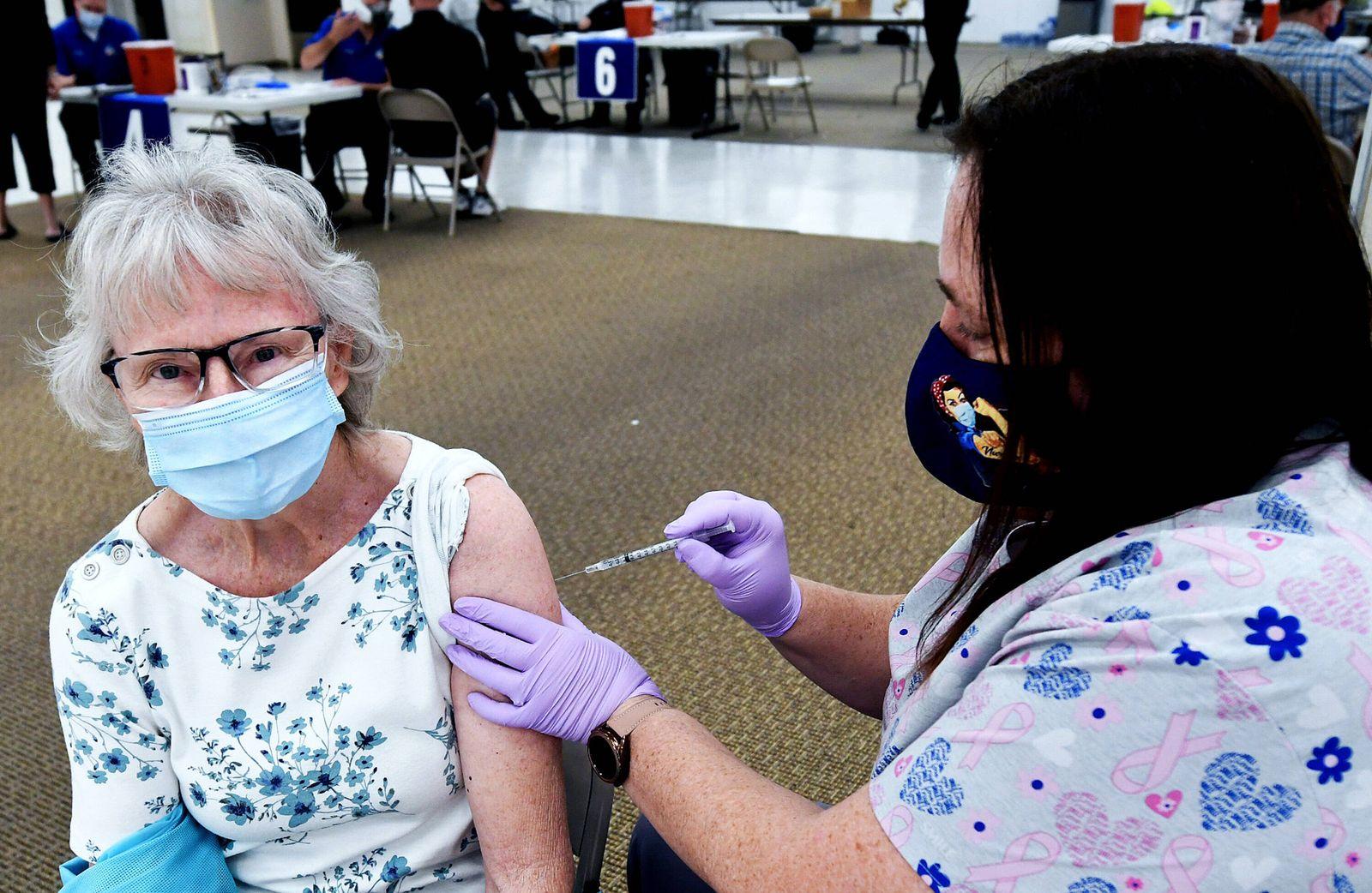 January 29, 2021, Leesburg, Florida, United States: Nurse Lacinda Snowberger gives Priscilla Lockhart a shot of the Pfi