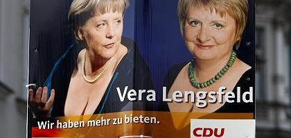 """The poster shows Christian Democratic candidate Vera Lengsfeld (right) alongside a 2008 photo of Angela Merkel above the slogan: """"We have more to offer."""""""