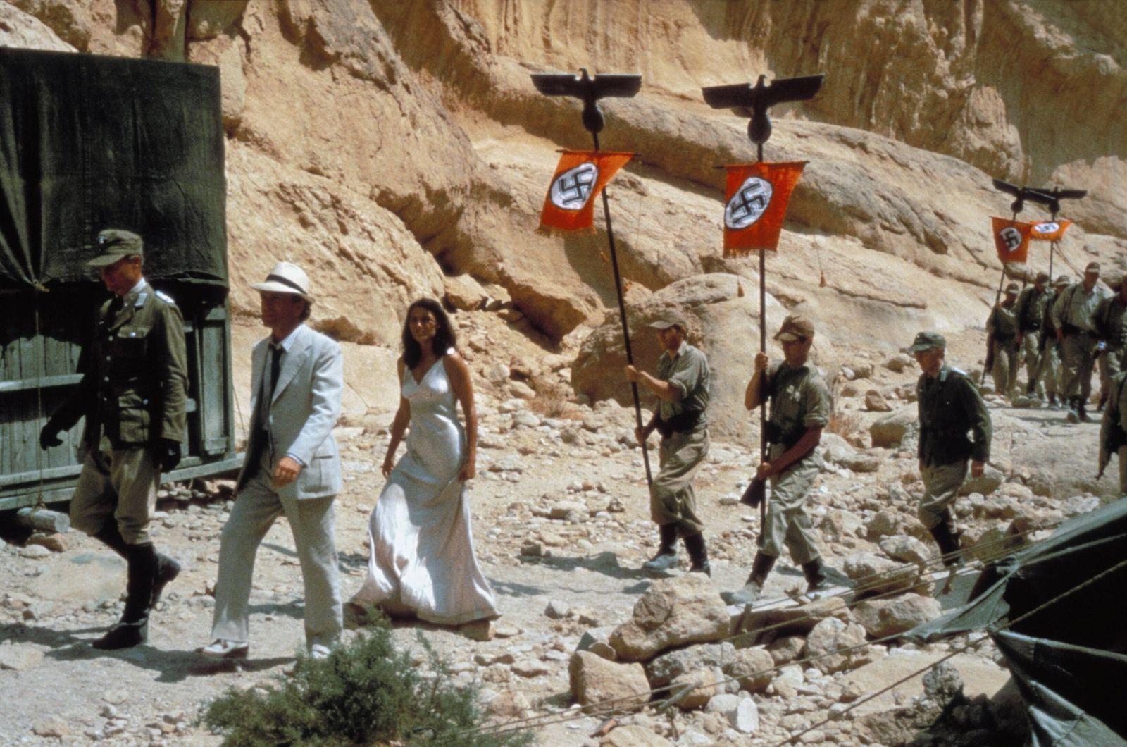 Paul Freeman & Karen Allen Characters: Dr. Rene Belloq, Marion Ravenwood Film: Raiders Of The Lost Ark; Indiana Jones 1