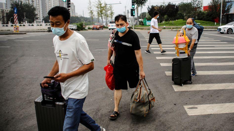 Wanderarbeiter in Peking, China: Die Corona-Pandemie hat den Arbeitsmarkt hart getroffen
