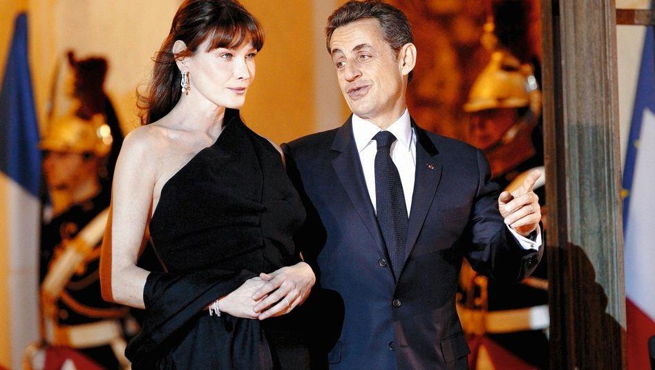 Präsident Sarkozy mit Gattin Bruni: »Gefühlsbündel auf der Suche nach Zuneigung«