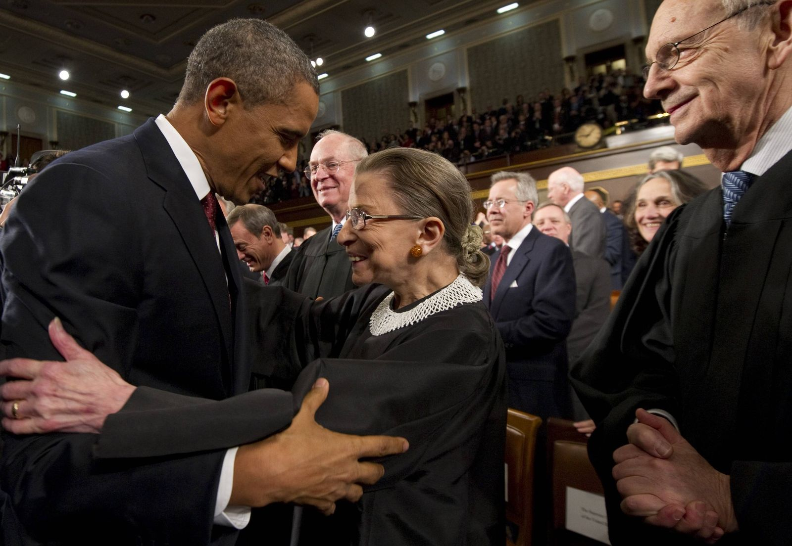 President Barack Obama greets US Supreme Court Justice Ruth Bader Ginsburg prior to his State of the Union address in f