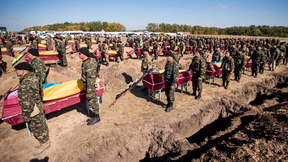 Massenbestattung in der Ostukraine