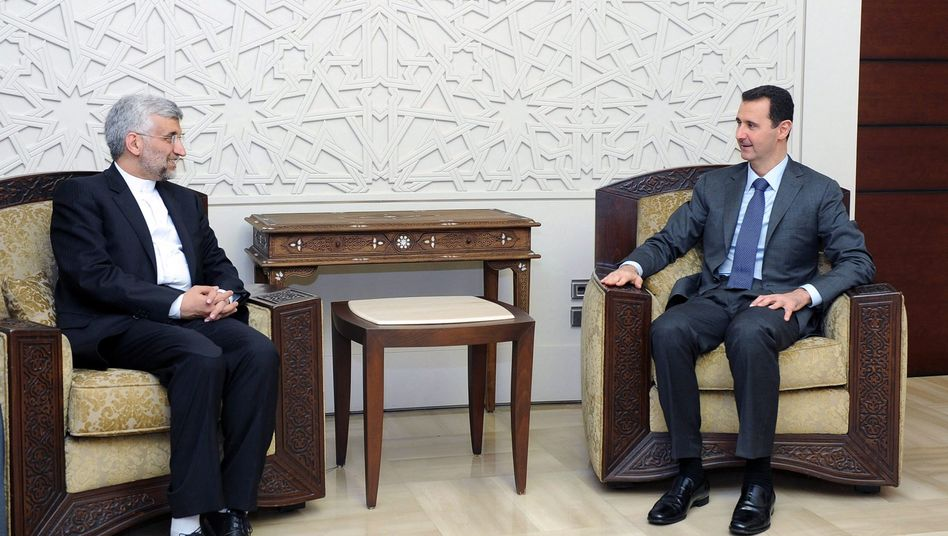 """Syriens Präsident Assad (r.), iranischer Unterhändler Dschalili: """"Keine Rücksicht"""""""