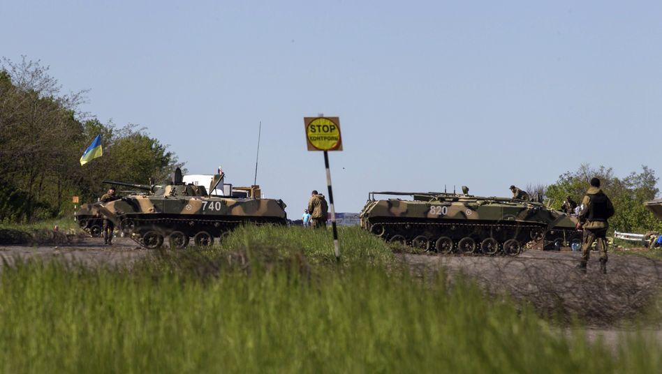 Checkpoint bei Slowjansk (7. Mai 2014): Berichte über Einsatz von US-Söldnern