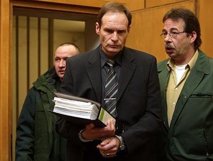 "Armin Meiwes (C) arrives for his second trial at Frankfurt""s district court."