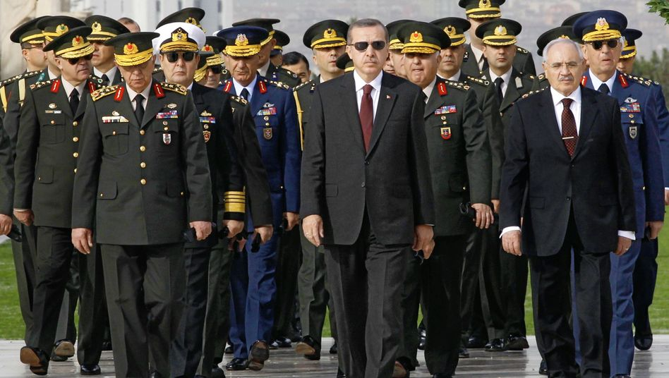 """Turkish Prime Minister Recep Tayyip Erdogan, center, has surrounded himself with """"an iron ring of sycophantic (but contemptuous) advisors,"""" according to US diplomatic cables."""