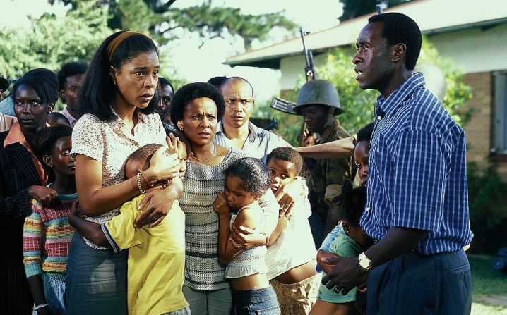 """A scene from the film """"Hotel Rwanda,"""" with actor Don Cheadle playing Paul Rusesabagina in 2004: """"Paul didn't turn anyone away."""""""