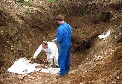 Slovenian forensic experts investigate the site discovered in 1999 by Slovenian highway workers near Maribor, where 1,179 skeletons were found in a World War II-era trench.