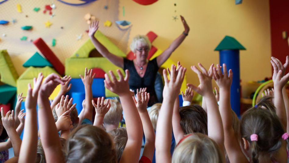 Kindergartenkinder (in Dortmund, Juli 2011): Ähnlich großzügig wie Erwachsene