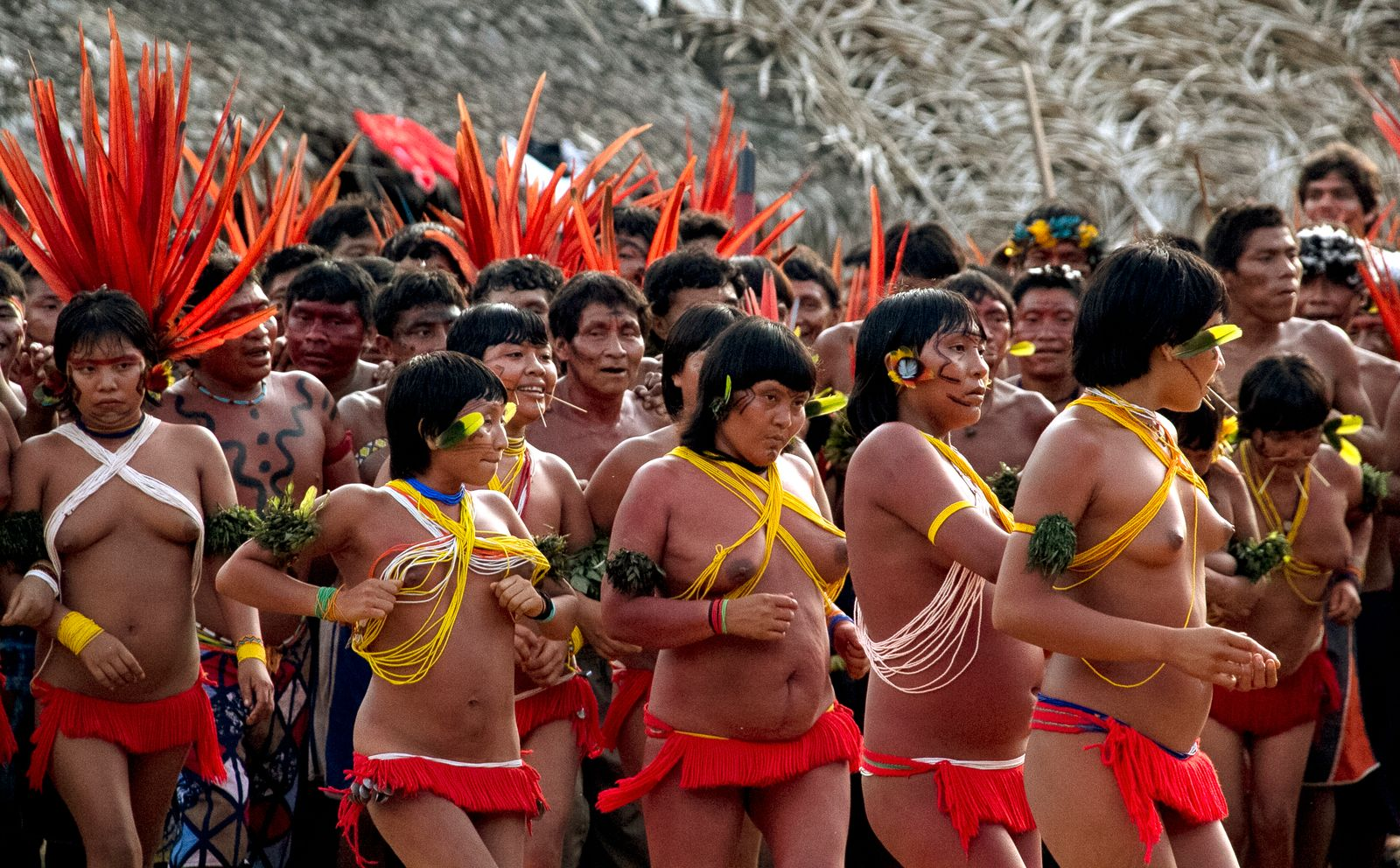 Yanomami Indians gather during a meeting of tribal members in Novo Demini