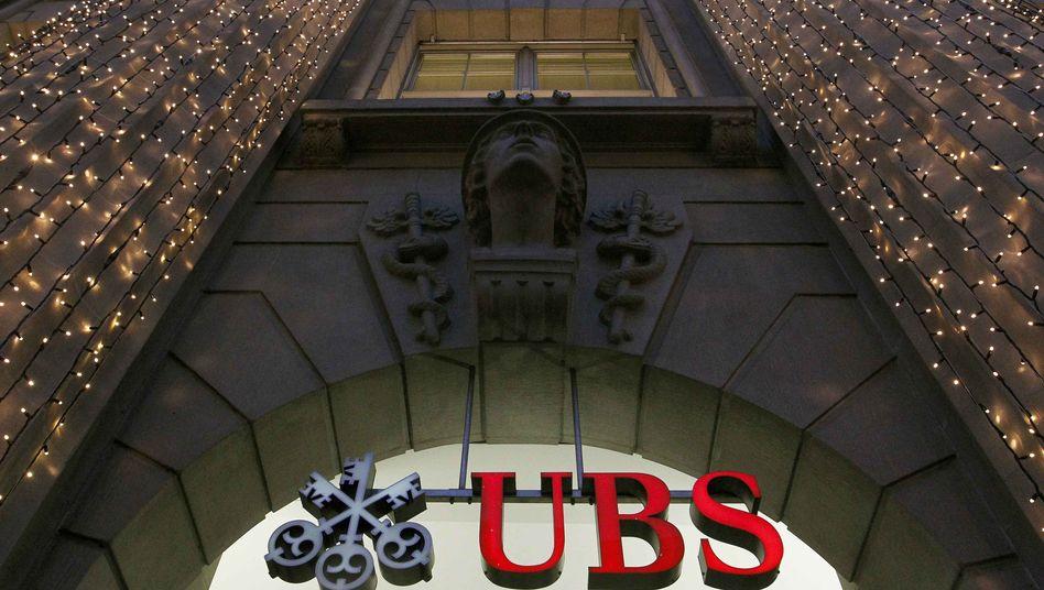 Christmas lights illuminate an office building of Swiss bank UBS in Zurich.