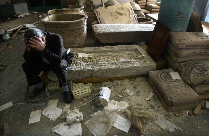 Iraqi National Museum Deputy Director Mushin Hasan amid the ruins of the museum following looting on April 13, 2003.