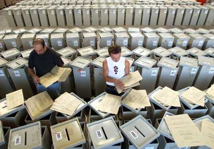Election offices can't keep up with all the applications they're getting for absentee ballots.